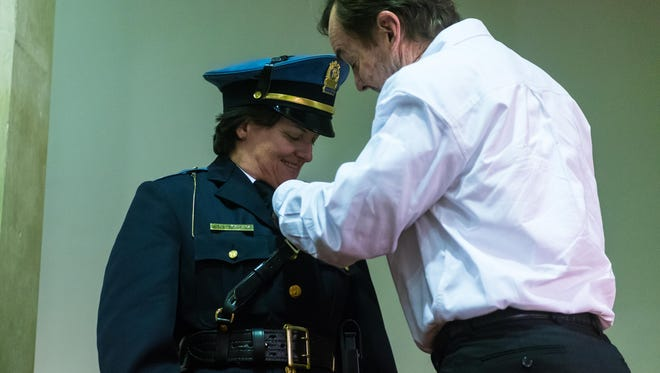 Captain Lene Bowers is pinned by her brother Michael Bowers during a promotion ceremony at Vineland City Hall on Tuesday, January 16.