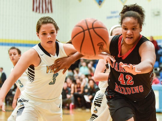 River Valley's Alexis Stevens (left) and Marion Harding's Zarreah Smith chase after a loose ball on Thursday night.