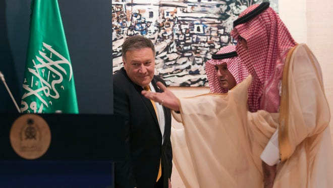 Secretary of State Mike Pompeo, left, is welcomed by Saudi Arabian Foreign Minister Adel al-Jubeir, center, as they attend a joint press conference at the Royal Terminal of King Khaled airport in Riyadh on April 29, 2018.