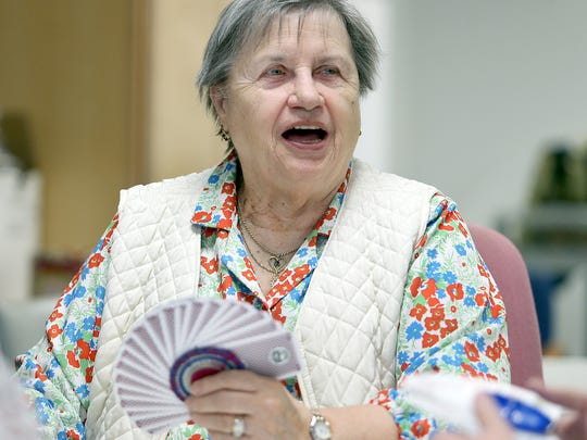 Eifriede Preston, of Port Orchard, plays pinochle Wednesday at the Givens Community Center in Port Orchard.