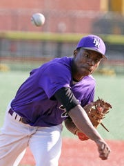 New Rochelle's JoJo Gray struck out ten batters over 8 1/3 innings as Mamaroneck defeated New Rochelle 2-1 in nine innings in a varsity baseball game at City Park in New Rochelle April 21, 2015. Gray held Mamaroneck scoreless for eight innings, but gave up two runs in the ninth to take the loss.