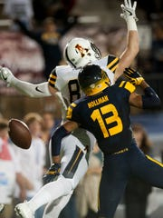 Toledo defensive back Ka'dar Hollman (13) breaks up
