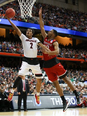 U of L's Quentin Snider, #2, beats NC State's Ralston Turner, #22, to the basket during their Sweet 16 in the NCAA tournament game in Syracuse, NY. March 27, 2015