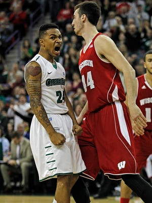 Green Bay's Keifer Sykes, left, reacts in front of Wisconsin's Frank Kaminsky after dunking on the first possession against Wisconsin during the first half of an NCAA college basketball game on Nov. 16.