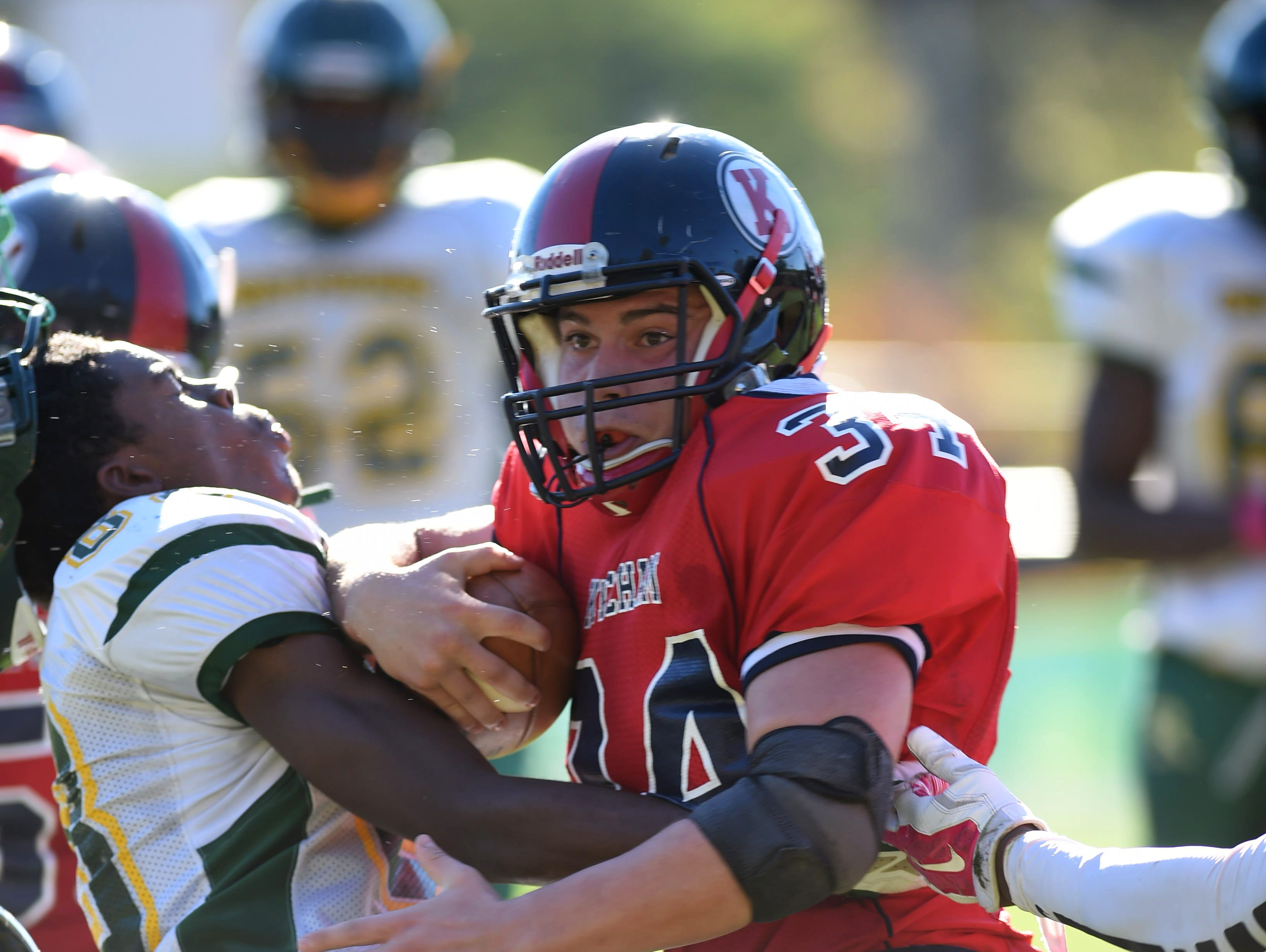 Ketcham's Jesse Pascale pushes past Ramapo's Carlos Colon during Saturday's game in Wappingers Falls.
