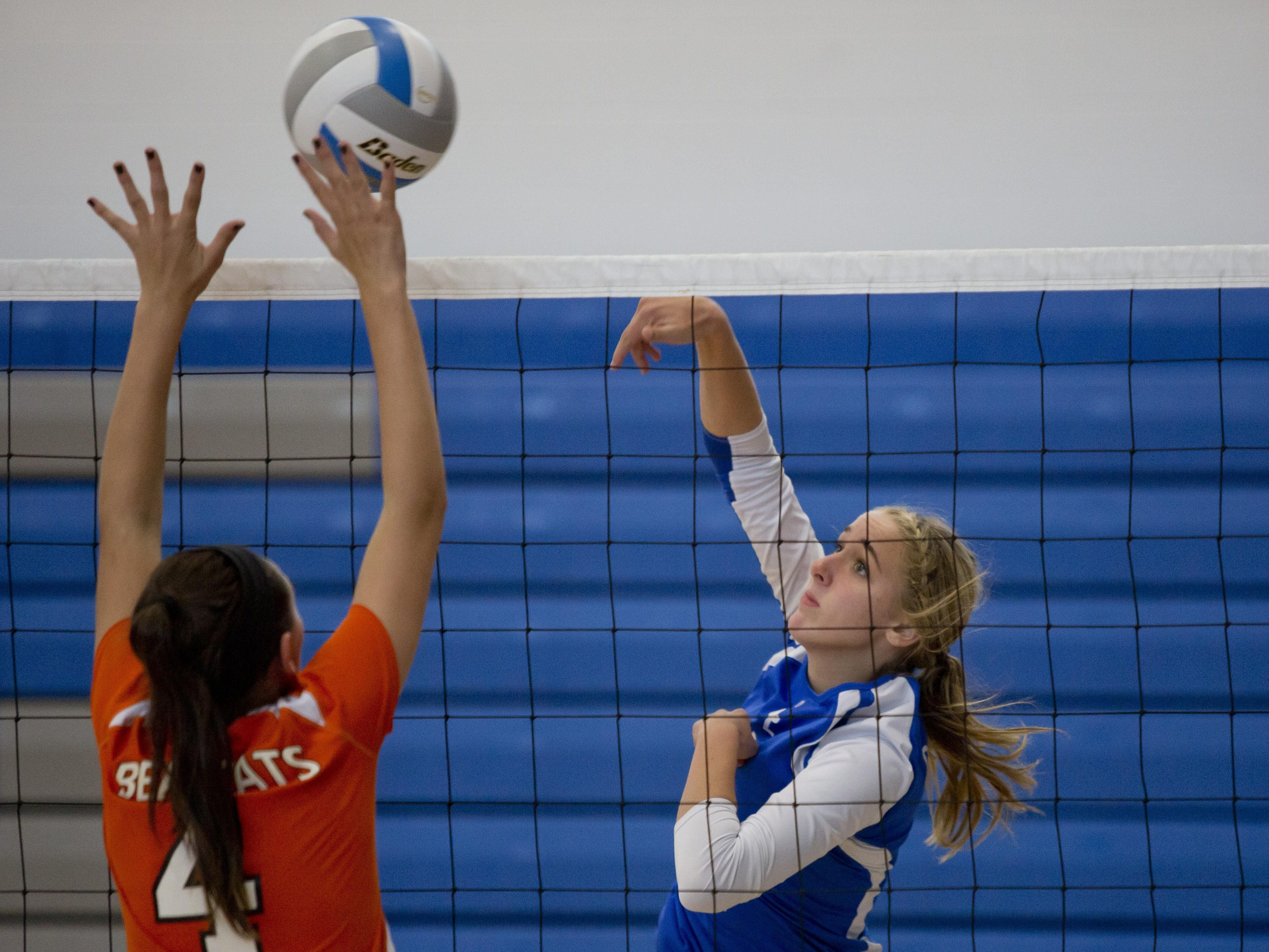 Cros-Lex's Lexie Davidson spikes the ball during the Pioneer Volleyball Invitational Saturday, September 12, 2015 at Cros-Lex High School.