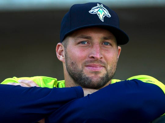 Apr 7, 2017; Columbia, SC, USA; Columbia Fireflies outfielder Tim Tebow (15) looks out of the dugout prior to the game against the Augusta GreenJackets at Spirit Communications Park. Mandatory Credit: Joshua S. Kelly-USA TODAY Sports ORG XMIT: USATSI-358511 ORIG FILE ID:  20170407_ggw_ak7_048.JPG