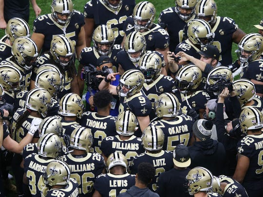 Jan 13, 2019; New Orleans, LA, USA; New Orleans Saints quarterback Drew Brees (9) huddles with teammates before a NFC Divisional playoff football game against the Philadelphia Eagles at Mercedes-Benz Superdome. Mandatory Credit: Chuck Cook-USA TODAY Sports