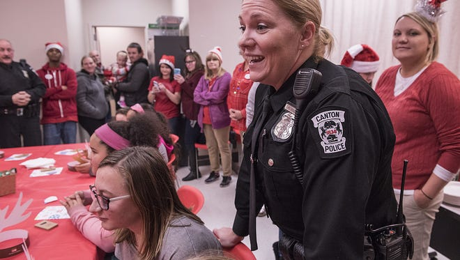 Officer Patty Esselink greets children during the Shop with a Cop program at Christmastime.