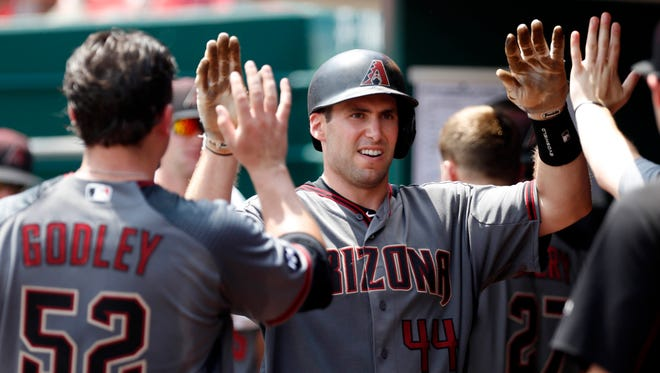 Jul 24, 2016: Arizona Diamondbacks first baseman Paul Goldschmidt (44) celebrates in the dugout after hitting a solo home run against the Cincinnati Reds during the fifth inning at Great American Ball Park.