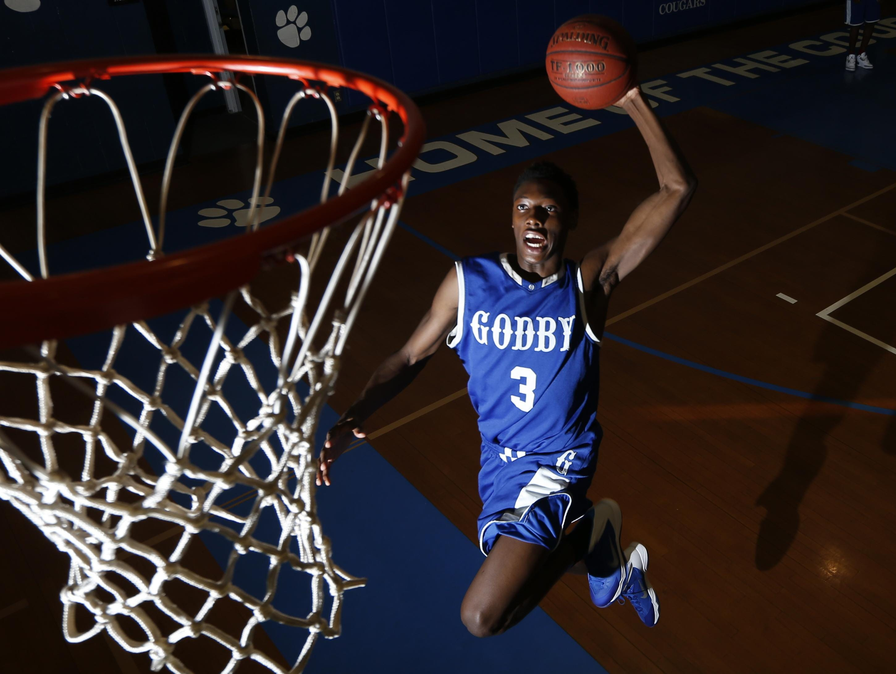 Godby senior Quan Jackson averaged 13 points per game to help the top-ranked and undefeated Cougars (31-0) win the Class 4A state title. He was named the 2015 All-Big Bend Co-Player of the Year.