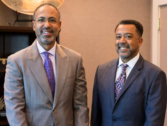 Attorneys Clyde Simien and Ricky Miniex at their office