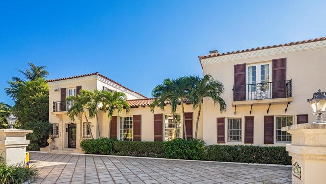 Just sold for a recorded $8 million, an eight-bedroom house at 220 Via Bellaria in Palm Beach has a smooth-stucco exteror and wrought-iron details. Designed by noted societ architect Maurice Fatio, it was built in 1929.