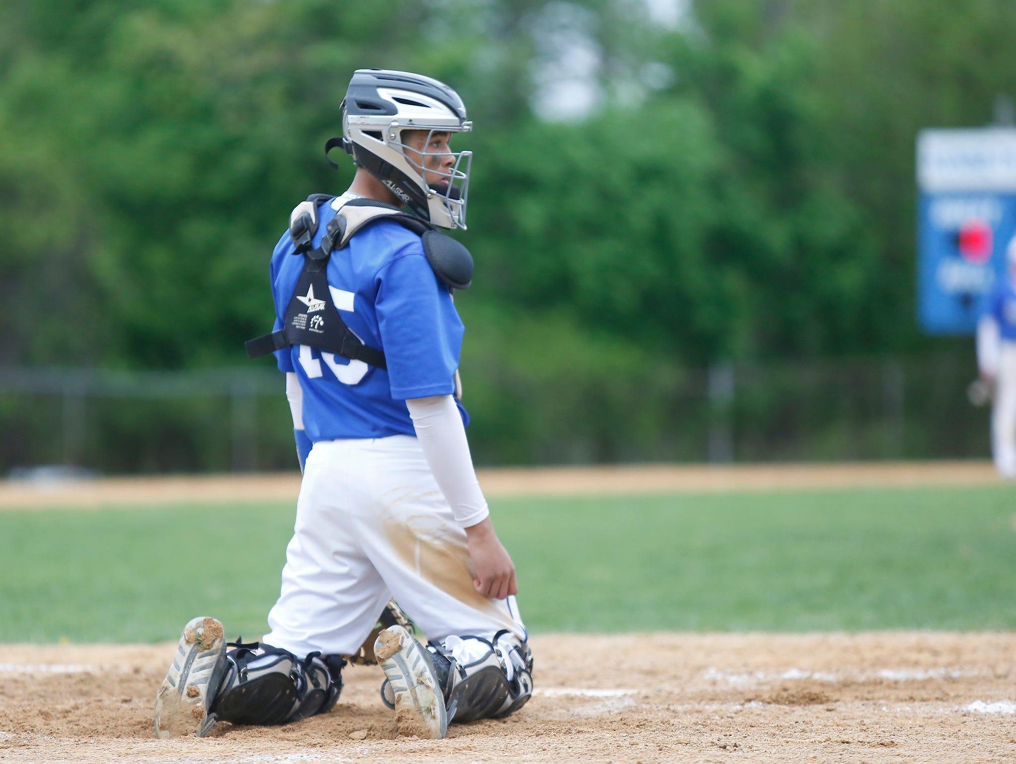 Hendrick Hudson catcher Daniel Weimar looks for a signal during a baseball game against Nanuet at Sunset Park in Montrose on Thursday, May 05, 2016. Hendrick Hudson won 6-2.