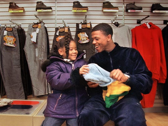 Taurean Moy of Booker T. Washington High in Memphis, Tenn., swaps hats with his sister Tabria Moy, 5, while shopping Wednesday, Dec. 6, 2000, for a new pair of basketball shoes. Moy set a national high school basketball record by hitting 24 of 43 3-point attempts during a game Tuesday, Dec. 5, 2000. He scored a total of 83 points.