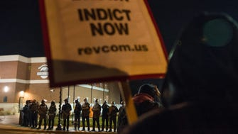 Police block protesters from the street at the Ferguson Police Department in Ferguson, Missouri, on Nov. 20, 2014.