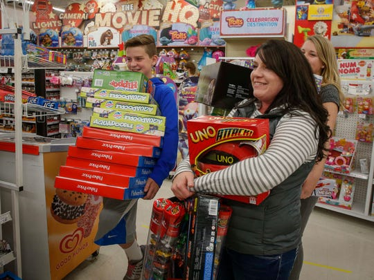 Erin Davis of Urbandale purchased several items for her daycare center, The Learning Loft, while shopping for deals at Toys R Us in Clive on Nov. 24, 2016.