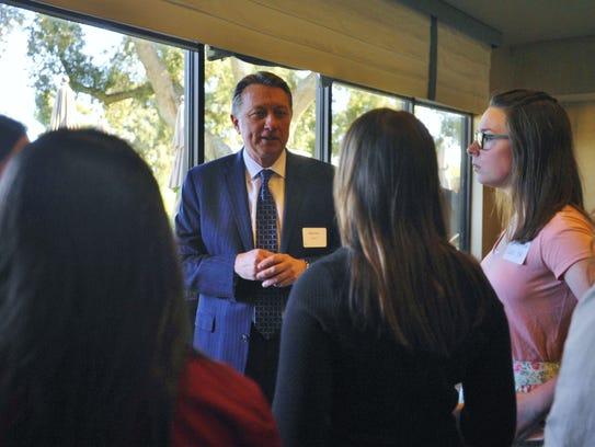 Mayor Warren Gubler speaks with Exeter high school