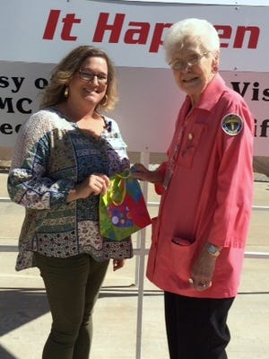 The Pink Follies $500 gift certificate winner Shelly Romero was congratulated by Auxilian Margie Aguayo April 23.