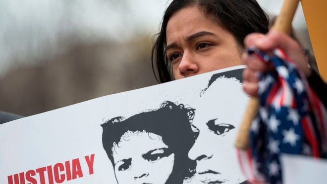 A young girl looks on as other immigrants and activists protest near the White House to demand that the Department of Homeland Security extend Temporary Protected Status (TPS) for more than 195,000 Salvadorans on Jan. 8, 2018 in Washington, D.C.
