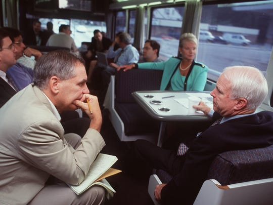 Arizona Sen. John McCain (right) is interviewed July 3, 1999, by Richard Sisk of the New York Daily News on his Straight Talk Express bus while on a four-day campaign tour of South Carolina.