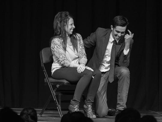Michael Carbonaro laughs with a volunteer.