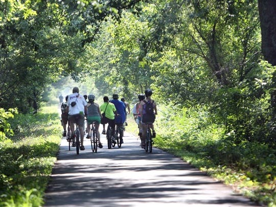 June 16, 2016 — Shortly after the official opening, a group of riders heads east on the newly completed 4.15-mile extension of the Shelby Farms Greenline to Cordova. (Stan Carroll/The Commercial Appeal)