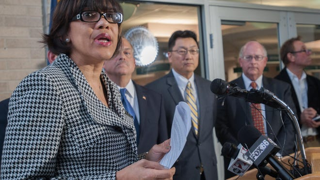 Flanked by mayors of major cities, Flint Mayor Karen Weaver speaks Tuesday about the city's need to replace its lead pipes.