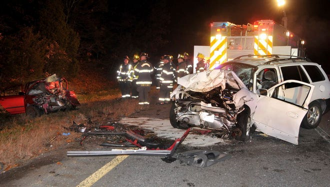 Emergency personnel work the scene after a fatal two-car collision on Interstate 495 southbound Nov. 24 in Plainville, Mass.