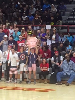 Students hold up a Donald Trump Fathead at an Indiana basketball game.