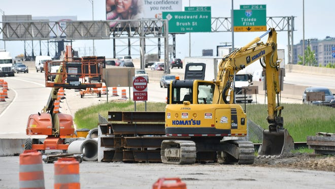A piece of Komatsu equipment is parked at the site of bridge construction over the I-94 expressway at Chene Street in Detroit on Wednesday.