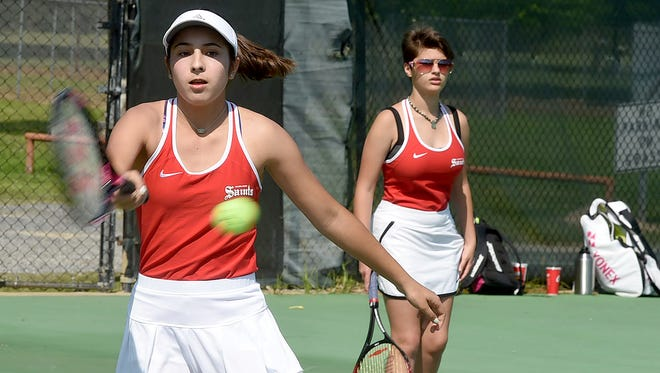 Academy of the Sacred Heart players participate in the OHS Tennis Tournament.