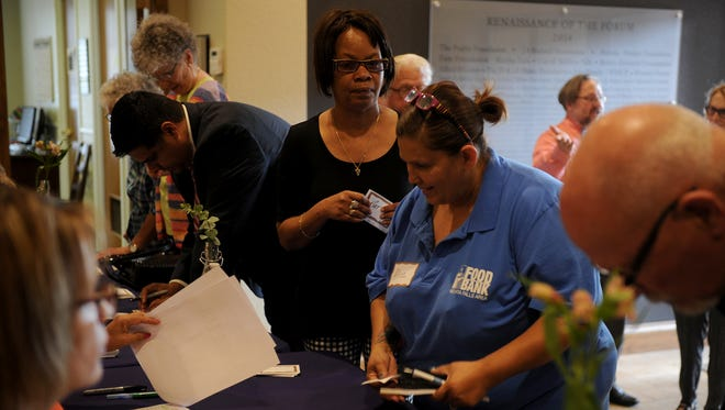 People check in at the Catholic Charities Fort Worth Northwest Poverty Summit Tuesday, May 16, 2017, at The Forum in Wichita Falls.