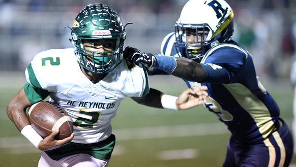 Reynolds' Kejuan Watkins carries the ball as Roberson's
