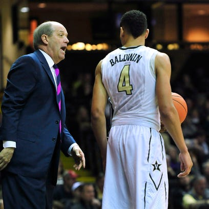 Vanderbilt coach Kevin Stallings, left, talks with