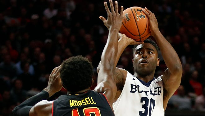 Butler forward Kelan Martin shoots over Maryland guard Darryl Morsell during the first half of an NCAA college basketball game in College Park, Md., Wednesday, Nov. 15, 2017.