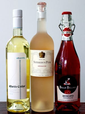 Wine bottles sealed with alternatives to corks include, from left, screw cap, glass cap and crown cap.