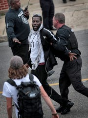 Keedran Franklin is arrested by Memphis police on April 3, 2018 during a protest outside 201 Poplar. Several others were arrested in the same incident, including Spanish-language reporter Manuel Duran.