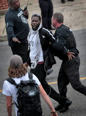 Keedran Franklin is arrested as protesters with the Memphis Coalition of Concerned Citizens, Comunidades Unidas en Una Voz and Fight for 15 clash with Memphis Police outside the Shelby County Justice Center during a demonstration to call attention to immigration issues April 3, 2018, in Memphis.