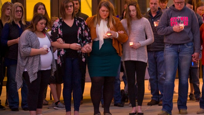 The friends and family of Mark Alan Nicholson, Charla Lee Nicholson and Tawni Alexis Nicholson gathered Saturday evening outside of the Bondurant-Farrar High School to comfort each other and celebrate their memory.