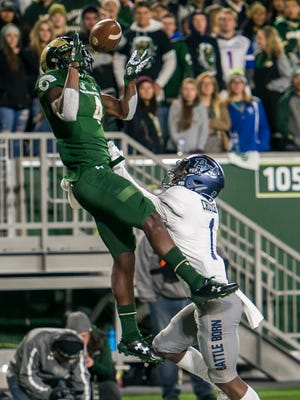 CSU receiver Michael Gallup (4) reels in a touchdown pass from quarterback Nick Stevens (7) over Nevada cornerback Vosean Crumbie (1) during the first half of a Homecoming game on Saturday night, Oct. 14, 2017, on campus in Fort Collins, Colo.