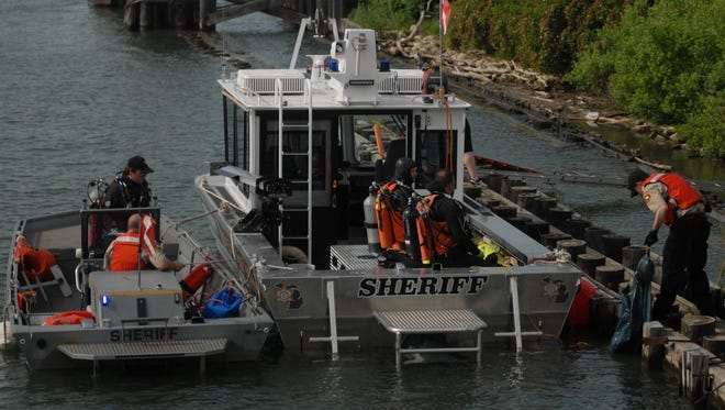 Members of the St. Clair County Dive Team train aboard Dive Boat Two, left, and Dive Boat Three.