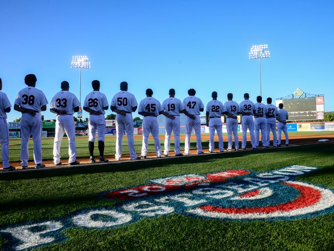 Binghamton Mets stood in formation for the singing of the National Anthem during the first playoff game on Wednesday at NYSEG Stadium.