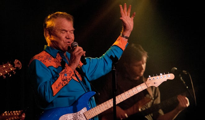Glen Campbell, 77, performs at The Birchmere in Alexandria, Va., in 2012, a year after the country legend was diagnosed with Alheimer's.