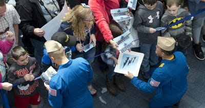 """Blue Angels members sign autographs for fans.  Pensacola has been featured as one of the """"South's Five-Star Destinations for Military & Public Service Groups"""" in a top 10 list produced by ConventionSouth magazine."""