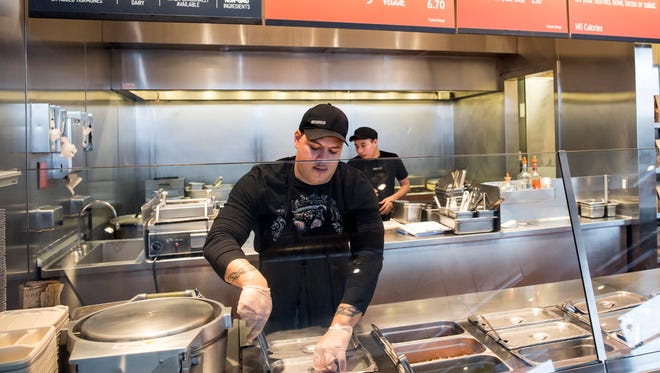 A Chipotle Mexican Grill employee prepares food in Seattle.