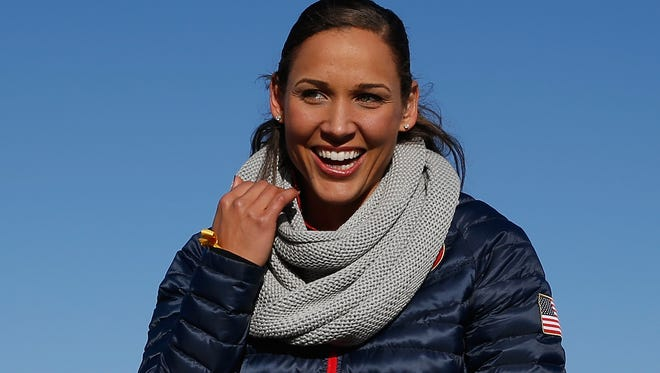 Lolo Jones of the United States smiles on the set of The Today Show ahead of the 2014 Winter Olympics in the Olympic Park on February 3, 2014 in Sochi, Russia.