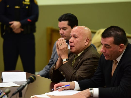 Joey Torres wipes tears from his eyes after being sentenced Tuesday to five years in prison for his role in a corruption scandal during his time as Paterson mayor.