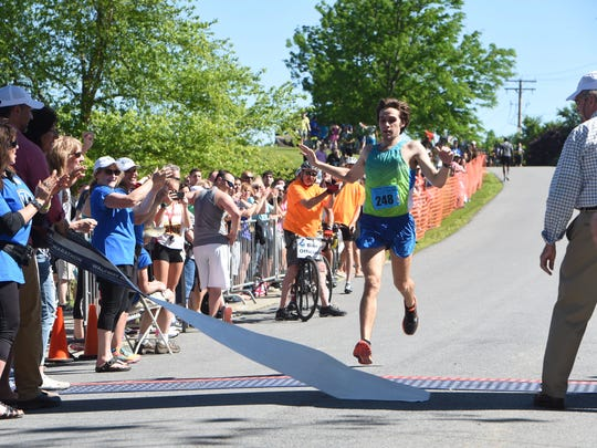 Mark Tabasco of Pittsfield, Massachusetts crosses the finish line to win the men's full marathon, part of the 2016 Walkway Marathon.