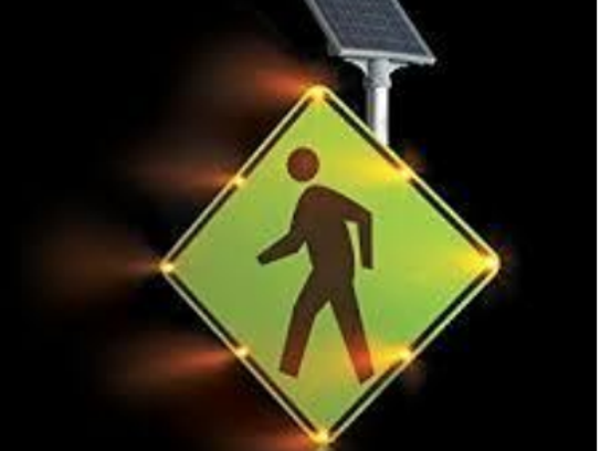 Two pedestrian triggered overhead blinker signs are